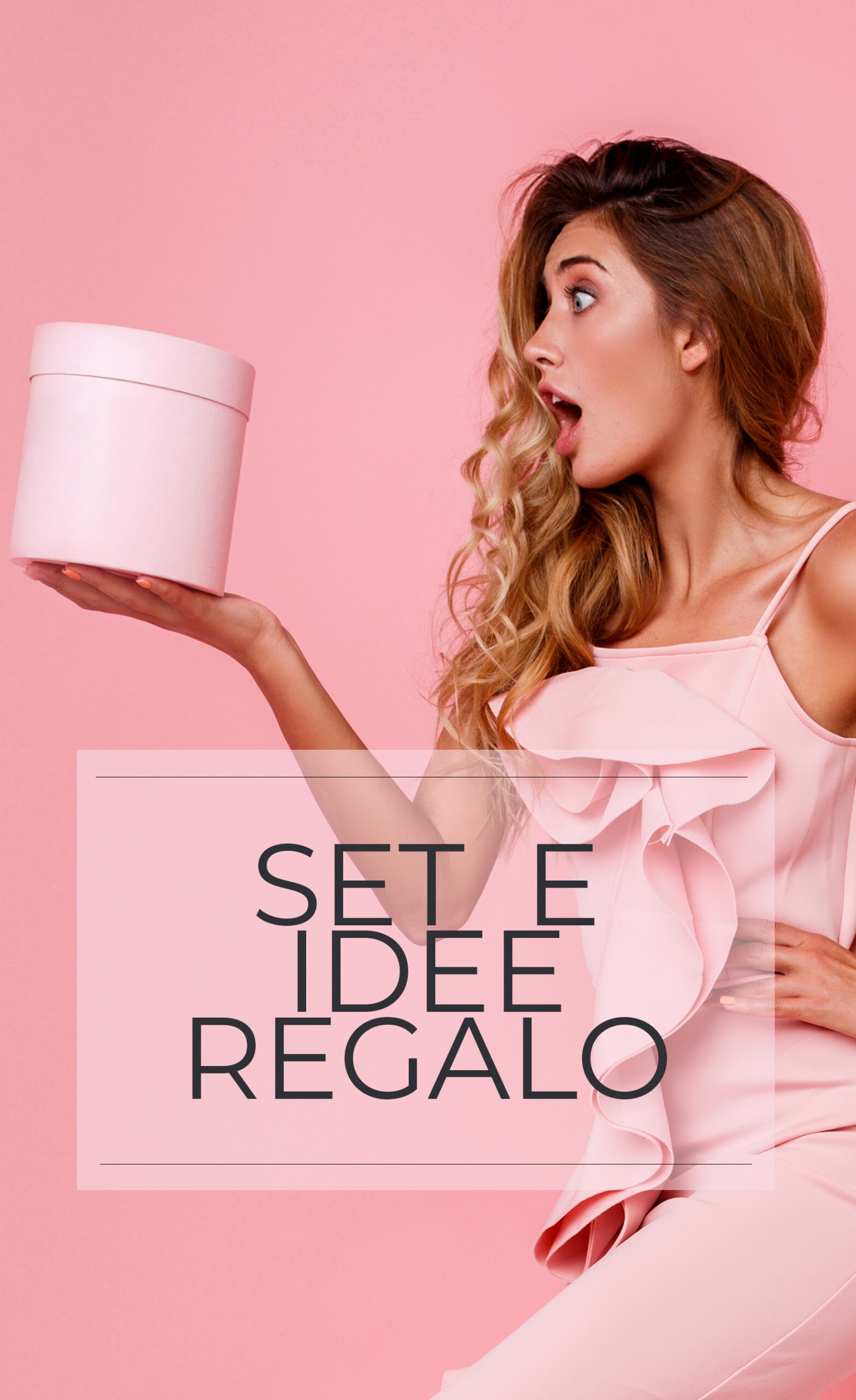Glamour blonde girl with surprise face  holding  gift box and standing over  rose  background in  elegant  pink dress . Ecstatic emotions.